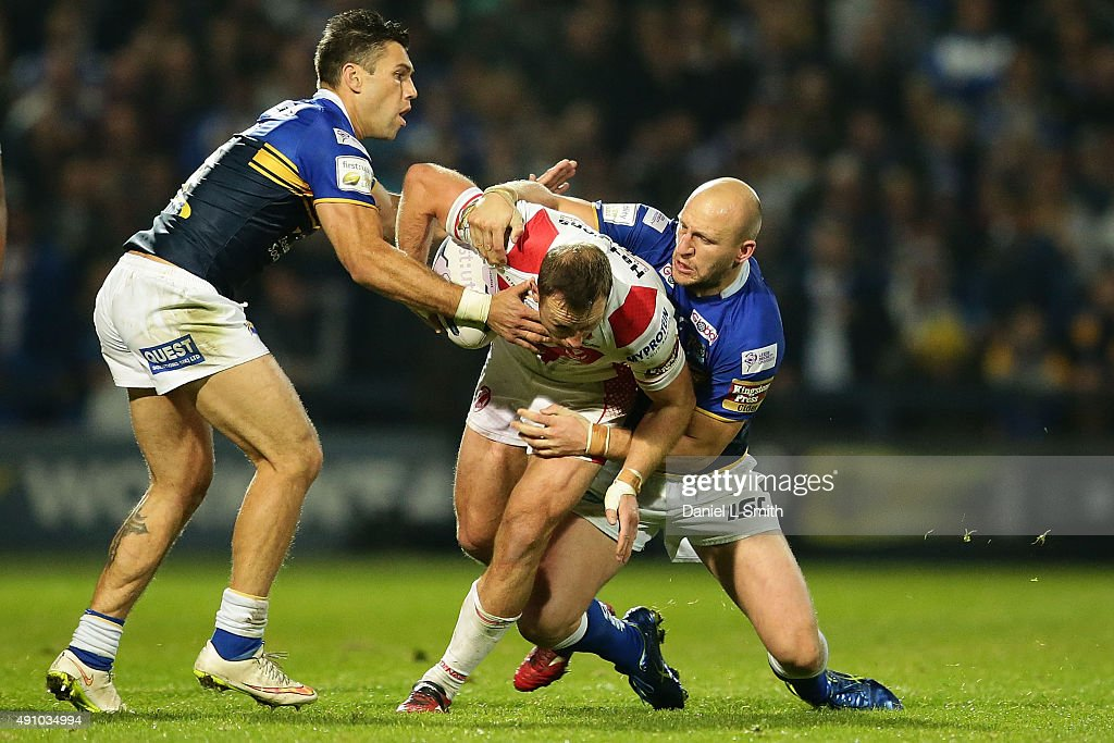Carl Ablett and Joel Moon of Leeds Rhinos tackles James Roby of St. Helens R.F.C during the First Utility Super League Semi Final between Leeds Rhinos and St Helens at Headingley Carnegie Stadium on October 2, 2015 in Leeds, England.