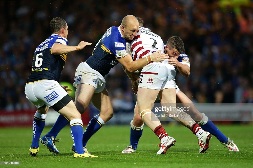 Carl Ablett of Leeds Rhinos assists a tackle against osh Charnley of Wigan Warriors during the Round 2 match of the First Utility Super League Super 8s between Leeds Rhinos and Wigan Warriors at Headingley Carnegie Stadium on August 14, 2015 in Leeds, England.