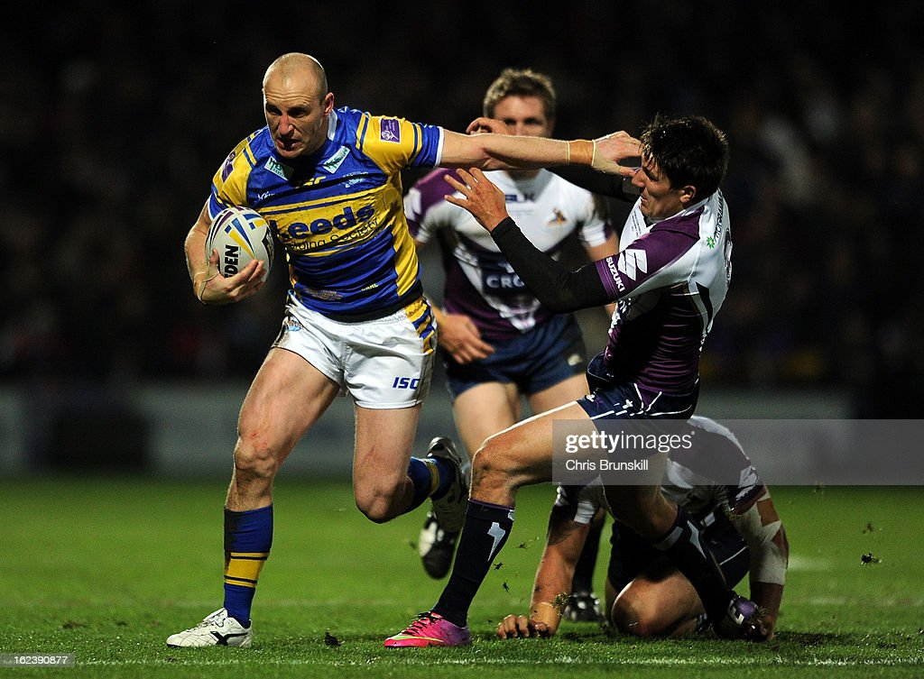 Carl Ablett of Leeds Rhinos in action with Jesse Bromwich of Melbourne Storm during the World Club Challenge match between Leeds Rhinos and Melbourne Storm at Headingley Carnegie Stadium on February 22, 2013 in Leeds, England.