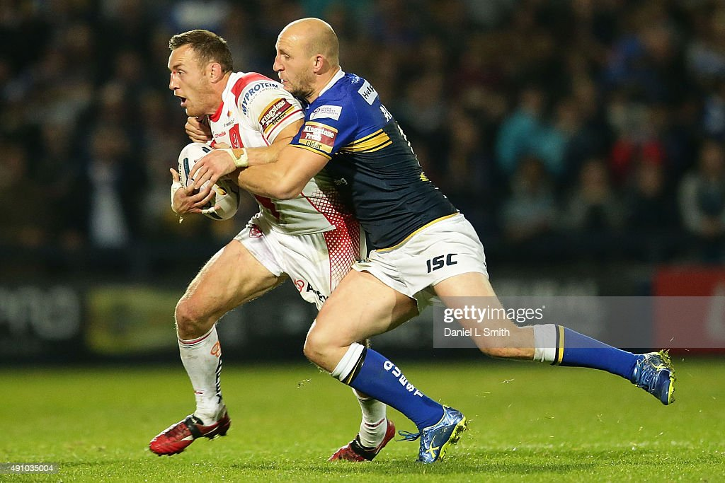 Carl Ablett of Leeds Rhinos tackles James Roby of St. Helens R.F.C during the First Utility Super League Semi Final between Leeds Rhinos and St Helens at Headingley Carnegie Stadium on October 2, 2015 in Leeds, England.