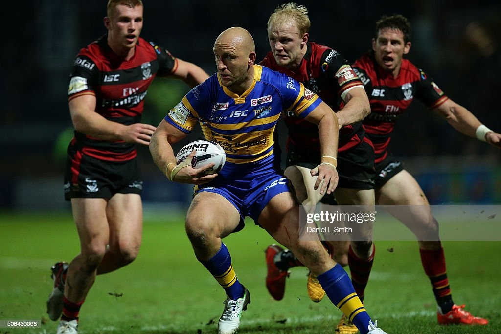 Carl Ablett of Leeds Rhinos under pressure from Rhys Evans of Warrington Wolves during the First Utility Super League opening match between Leeds Rhinos and Warrington Wolves at Headingley Carnegie Stadium on February 4, 2016 in Leeds, England.