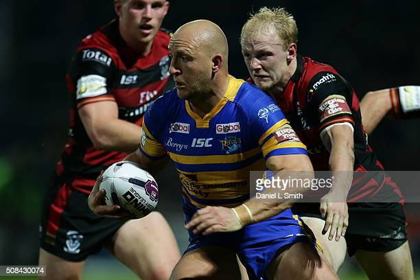 Carl Ablett of Leeds Rhinos under pressure from Rhys Evans of Warrington Wolves during the First Utility Super League opening match between Leeds...