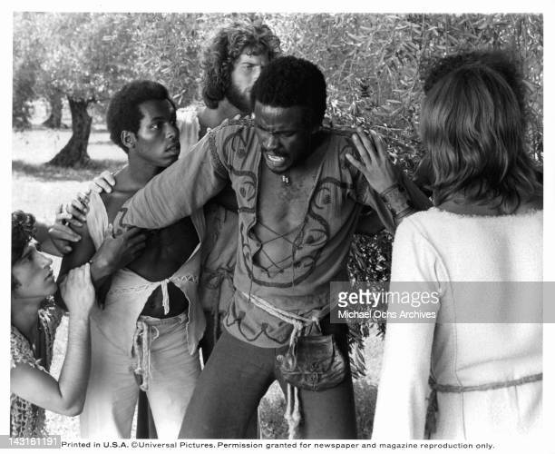 Carl Anderson being held back by unknown actors in a scene from the film 'Jesus Christ Superstar', 1973.