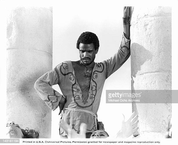 Carl Anderson leaning against a pillar in a scene from the film 'Jesus Christ Superstar' 1973