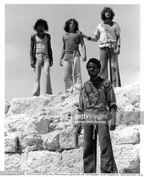 Carl Anderson stands below three unknown actors standing above him on cliff in a scene from the film 'Jesus Christ Superstar', 1973.