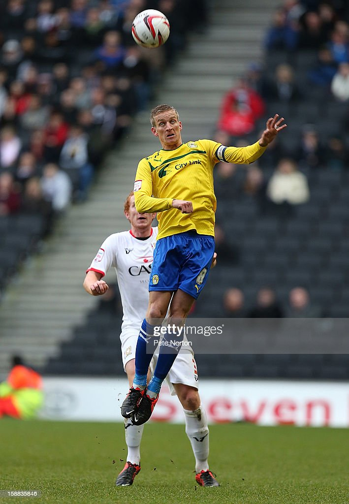 Carl Baker of Coventry City rises to head the ball during the npower League One match between Milton Keynes Dons and Coventry City at Stadium mk on December 29, 2012 in Milton Keynes, England.