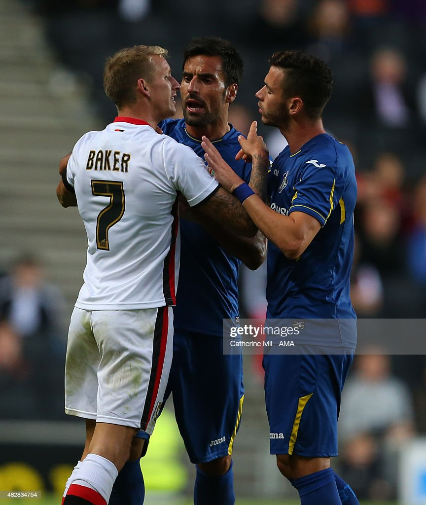 Carl Baker of MK Dons he has words with Juan Rodriguez and Alvaro Vazquez of Getafe during the pre-season friendly between MK Dons and Getafe at Stadium mk on July 28, 2015 in Milton Keynes, England.
