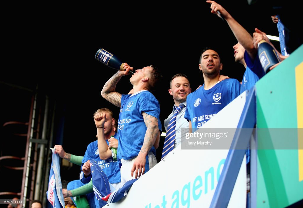 Carl Baker of Portsmouth drinks champagne after the Sky Bet League Two match between Portsmouth and Cheltenham Town at Fratton Park on May 6, 2017 in Portsmouth, England.