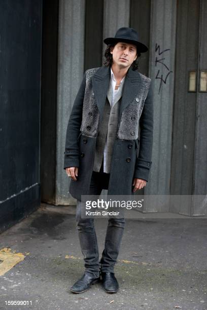 Carl Barat musician wearing Burberry shoes and jacket, a hat from Brazil, H and M jeans and a J Lindberg shirt on day 2 of London Mens Fashion Week...
