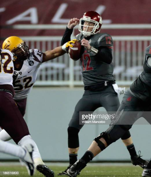 Carl Bradford of the Arizona State Sun Devils blocks a pass by Connor Halliday of the Washington State Cougars during the game at Martin Stadium on...
