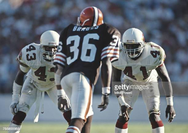 Carl Carter and Lonnie Young Defensive Backs for the Arizona Cardinals keep their eyes on Stephen Braggs of the Cleveland Browns during their...