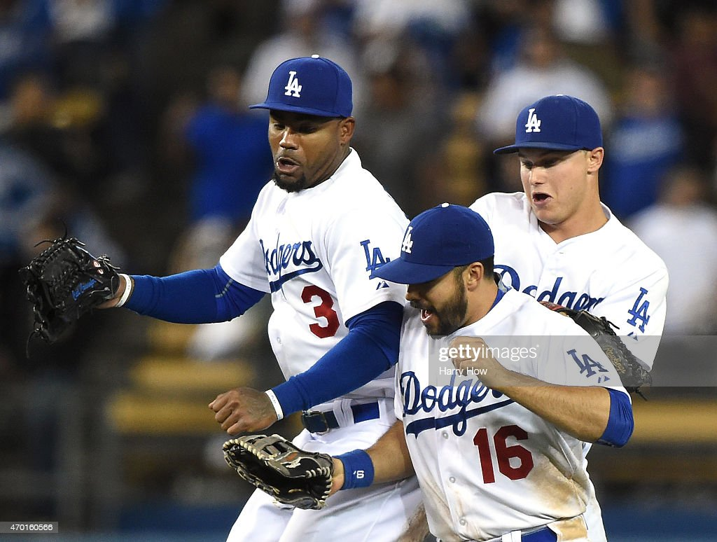 Carl Crawford #3, Andre Ethier #16 and Joc Pederson #31 of the Los Angeles Dodgers celebrate a 7-3 win over the Colorado Rockies at Dodger Stadium on April 17, 2015 in Los Angeles, California.