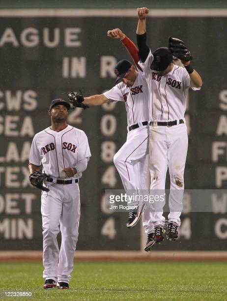 Carl Crawford Jacoby Ellsbury and Josh Reddick of the Boston Red Sox celebrate a 40 win over the Oakland Athletics at Fenway Park August 27 2011 in...