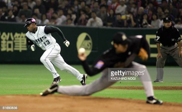 Carl Crawford of Tampa Bay Devil Rays dashes to try the second base while Japanese pitcher Shunsuke Watanabe of Lotte Marines throws the ball in the...