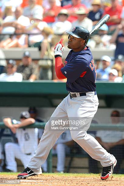 Carl Crawford of the Boston Red Sox bats against the Detroit Tigers during the spring training game at Joker Marchant Stadium on March 15 2011 in...