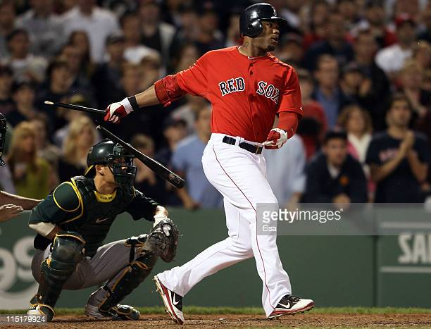 Carl Crawford of the Boston Red Sox hits a 2 RBI single in the seventh inning as Kurt Suzuki of the Oakland Athletics defends on June 3 2011 at...