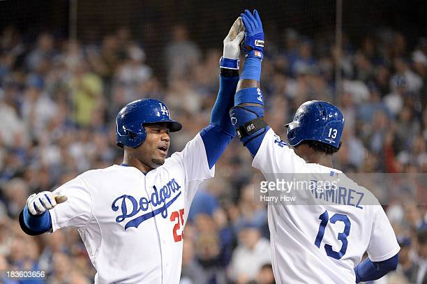 Carl Crawford of the Los Angeles Dodgers celebrates with Hanley Ramirez after Crawford hits a solo home run in the third inning against the Atlanta...
