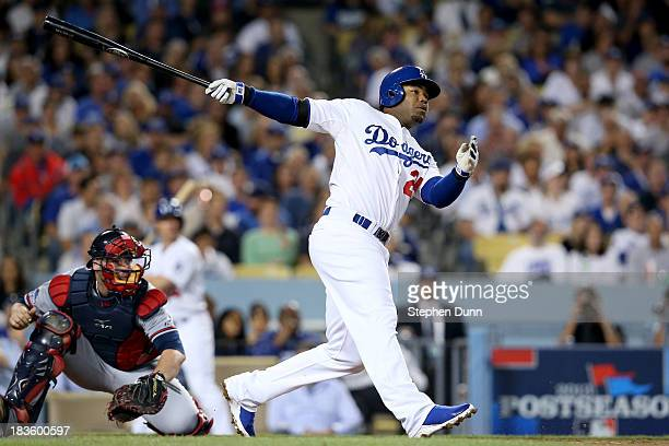 Carl Crawford of the Los Angeles Dodgers hits a solo home run in the third inning against the Atlanta Braves in Game Four of the National League...