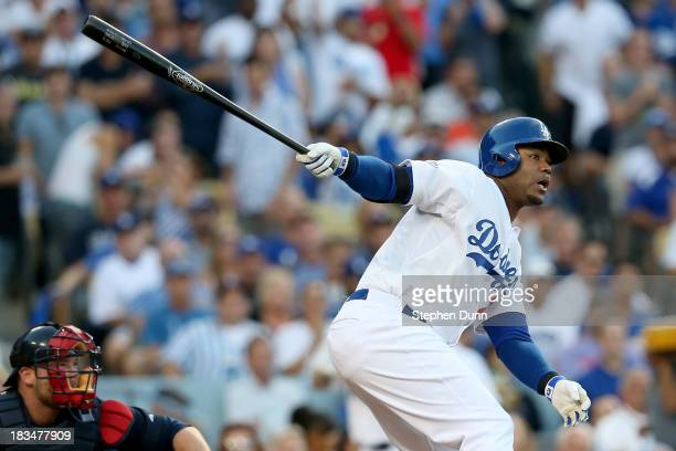 Carl Crawford of the Los Angeles Dodgers hits a threerun home run in the second inning against the Atlanta Braves during Game Three of the National...