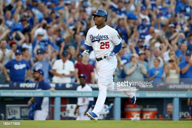 Carl Crawford of the Los Angeles Dodgers rounds the bases after hitting a threerun home run in the second inning against the Atlanta Braves during...