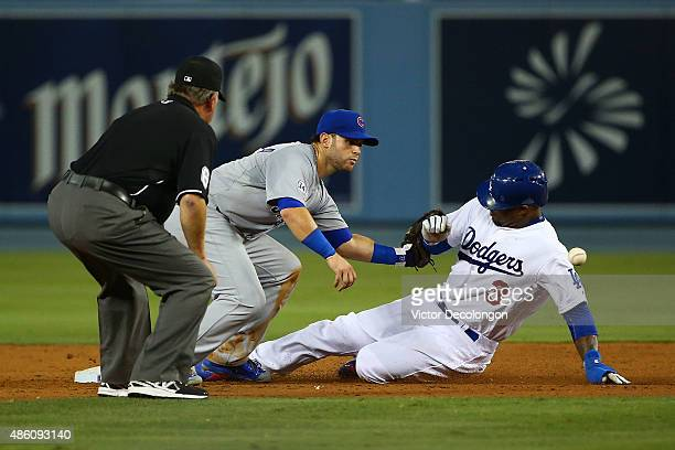 Carl Crawford of the Los Angeles Dodgers slides into second base as Tommy La Stella of the Chicago Cubs waits to catch the throw to second in the...