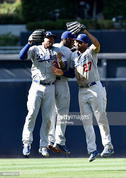 Carl Crawford of the Los Angeles Dodgers Yasiel Puig and Matt Kemp celebrate after beating the San Diego Padres 71 in a baseball game at Petco Park...