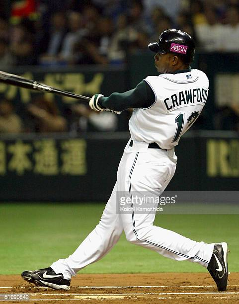 Carl Crawford of the Tampa Bay Devil Rays rhits a home run during the 2nd game of the exhibition series between US MLB and Japanese Professional...