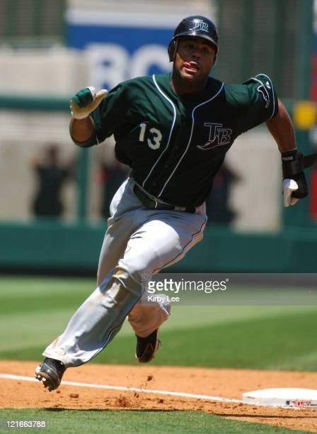 Carl Crawford of the Tampa Bay Devil Rays rounds third base to score in the fifth inning of 75 loss to the Los Angeles Angels of Anaheim at Angel...