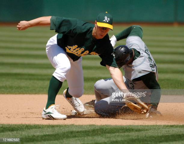 Carl Crawford of the Tampa Bay Devil Rays slides into second base beneath the tag of Mark Ellis for a stolen base during 32 victory at McAfee...