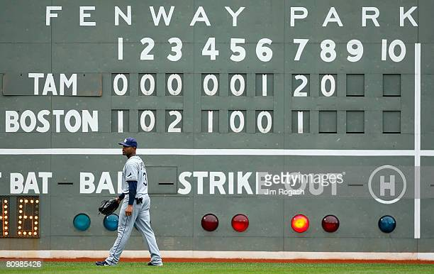 Carl Crawford of the Tampa Bay Rays walks by the score board during a game with the Boston red Sox at Fenway Park on May 4 2008 in Boston...