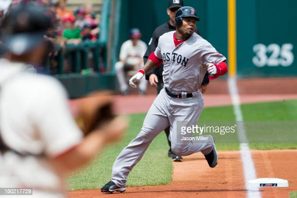 Carl Crawford rounds third base on his way home off a double by Dustin Pedroia of the Boston Red Sox during the first inning at Progressive Field on...