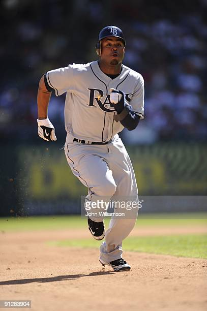 Carl Crawford#13 of the Tampa Bay Rays runs and advances safely to third base after he tagged up at second base on a fly ball to the outfield during...