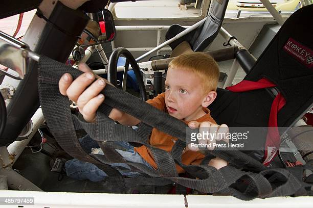 Adrien Williams Of South Thomaston Closes The Screen On His Grandfathers Car During Maine Vintage