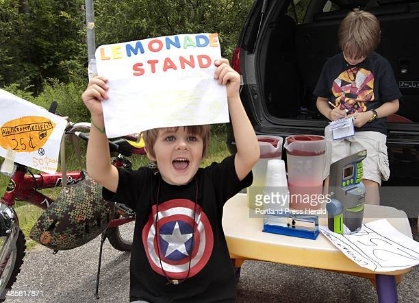 Carl D. Walsh/Staff Photographer: Four year-old Griffin Marley tries to attract business as his brother Cooper, 7 does some bookkeeping at roadside...