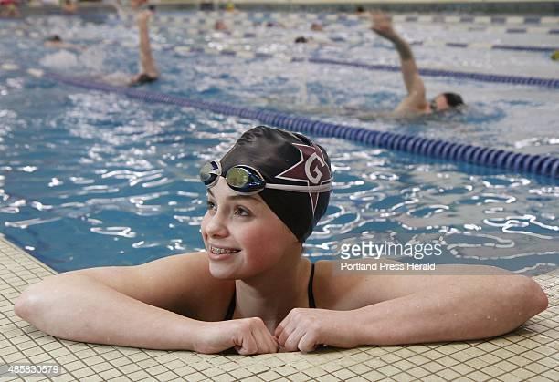 Greely High School sophomore and Westbrook Seals club team swimmer Sarah Easterling rests poolside during practice at the Davan Pool in Westbrook...