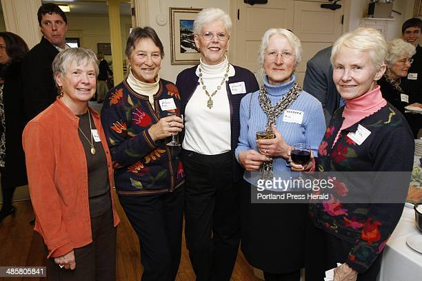 Members of the Habitat For Humanity Wednesday Group gather at a Habitat For Humanity volunteer dinner at the Woodford's Club in Portland on Thursday...