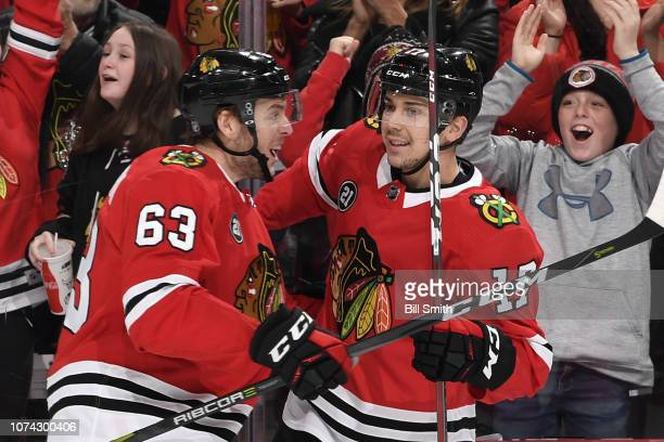 Carl Dahlstrom and Dylan Strome of the Chicago Blackhawks celebrate after Strome scored against the San Jose Sharks in the first period at the United...