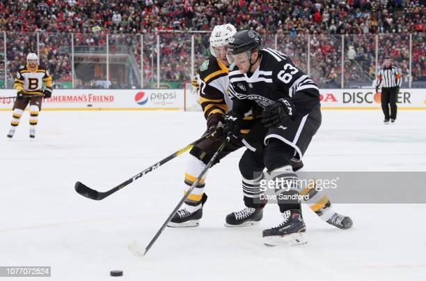 Carl Dahlstrom of the Chicago Blackhawks battles with Patrice Bergeron of  the Boston Bruins during the. 2019 Bridgestone NHL Winter Classic ... cff53f1c7