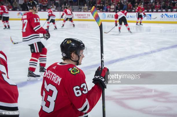 Carl Dahlstrom of the Chicago Blackhawks warms up with Pride Tape on his stick in honor of Hockey Is For Everyone night prior to the game against the...