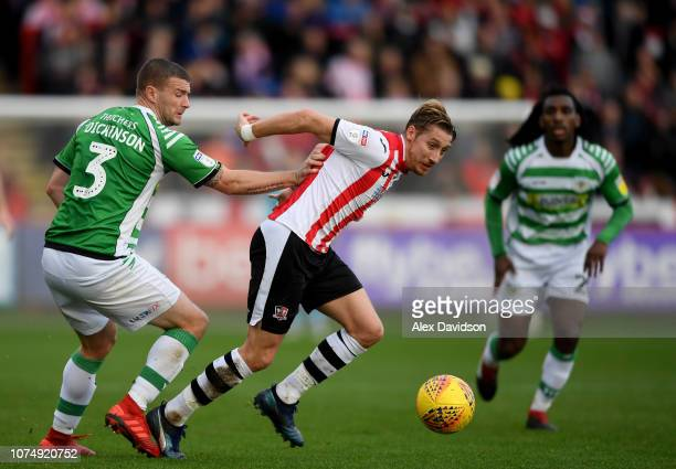 Carl Dickinson of Yeovil Town tackles Lee Martin of Exeter City during the Sky Bet League Two match between Exeter City and Yeovil Town at St James...