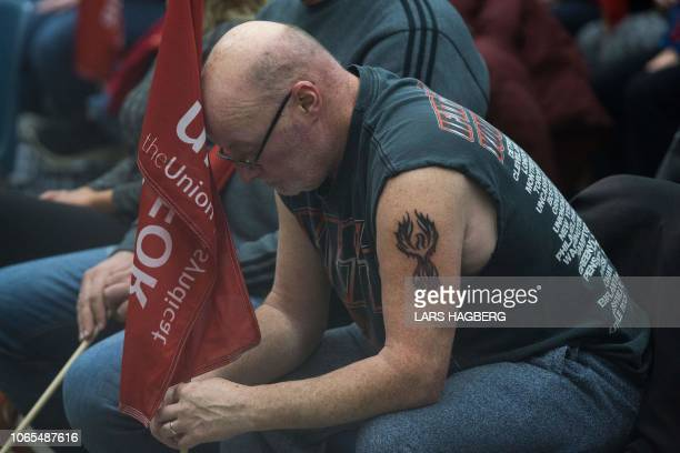 Carl Dillmam who has worked at the General Motors plant for 37 years sits with union members in Oshawa Ontario on November 26 2018 In a massive...