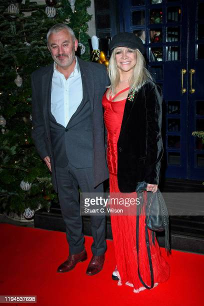 Carl Douglas and Jo Wood attend Tramp's Big 50th Anniversary at Tramp on December 17 2019 in London England
