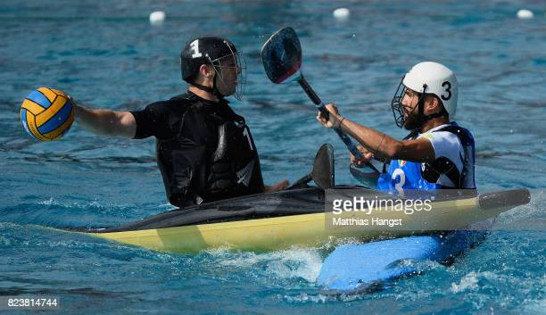 Carl Duncan of New Zealand is challenged by Edoarda Corvaia of Itlay during the Canoe Polo Men's match between Italy and New Zealand of The World...