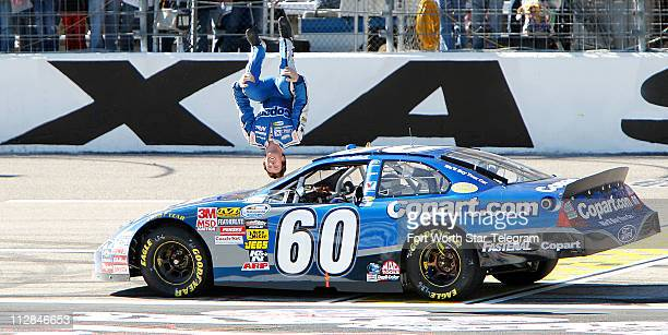 Carl Edwards back flips off of his car after winning the NASCAR Nationwide Series O'Reilly Auto Parts Challenge at Texas Motor Speedway in Fort Worth...