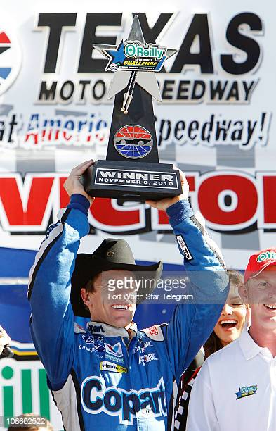 Carl Edwards celebrates his win in the NASCAR Nationwide Series O�Reilly Auto Parts Challenge at Texas Motor Speedway in Fort Worth Texas Saturday...