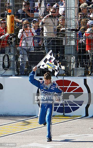 Carl Edwards celebrates his win in the NASCAR Nationwide Series O'Reilly Auto Parts Challenge at Texas Motor Speedway in Fort Worth Texas Saturday...