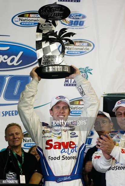 Carl Edwards celebrates winning the NASCAR Nationwide Series Ford 300 at Homestead-Miami Speedway on November 15, 2008 in Homestead, Florida.