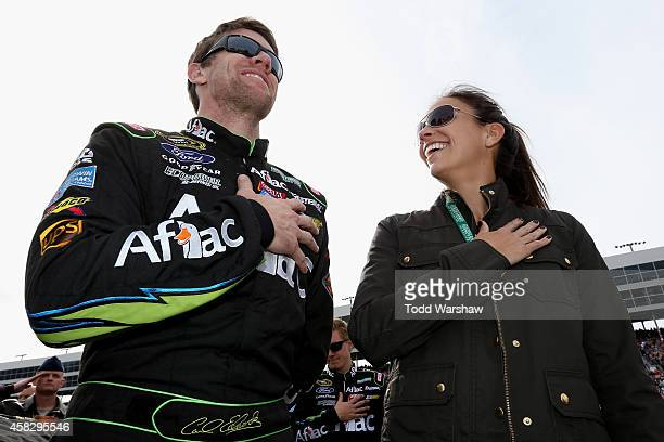 Carl Edwards driver of the Aflac Ford and his wife Kate stands on the grid during prerace ceremonies for the NASCAR Sprint Cup Series AAA Texas 500...