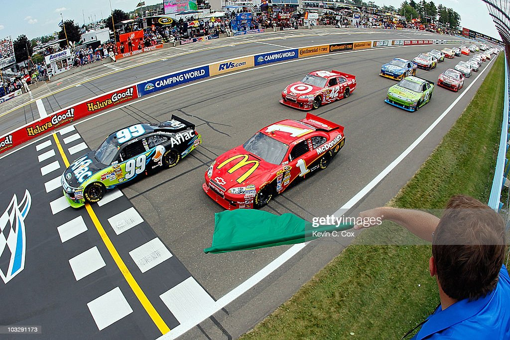 Carl Edwards, driver of the #99 Aflac Ford, and Jamie McMurray, driver of the #1 McDonalds's Chevrolet, lead the field to the green to start the NASCAR Sprint Cup Series Heluva Good! Sour Cream Dips at Watkins Glen International on August 8, 2010 in Watkins Glen, New York.