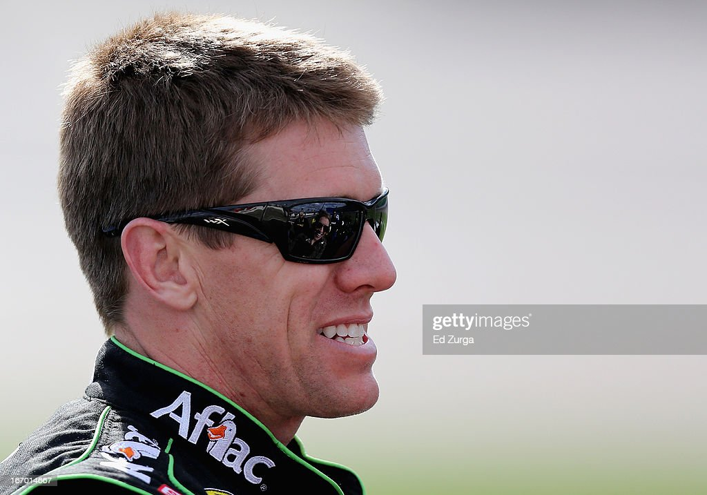 Carl Edwards, driver of the #99 Aflac Ford, stands on the grid during qualifying for the NASCAR Sprint Cup Series STP 400 at Kansas Speedway on April 19, 2013 in Kansas City, Kansas.
